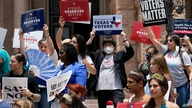 Demonstrators join a rally to protest proposed voting bills on the steps of the Texas Capitol, Tuesday, July 13, 2021, in…