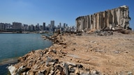 Rubble and debris remain around towering grain silos gutted in the site of a massive deadly explosion in August last year, at…