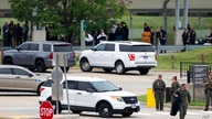 Emergency personnel respond outside the Pentagon Metro area Tuesday, Aug. 3, 2021, at the Pentagon in Washington. Gunshots were…