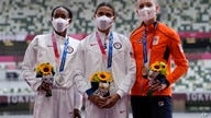 Gold medalist Sydney McLaughlin, of the U.S., center, stands with silver medalist Dalilah Muhammad, of the U.S, left, and bronze medalist Femke Bol, of the Netherlands, during the medal ceremony for the women's 400-meter hurdles, Aug. 4, 2021, in Tokyo.