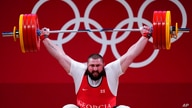 Lasha Talakhadze of Georgia competes in the men's +109kg weightlifting event, at the 2020 Summer Olympics, Wednesday, Aug. 4,…