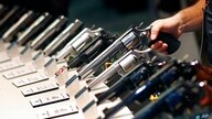 FILE - In this Jan. 19, 2016, file photo, handguns are displayed at the Smith & Wesson booth at the Shooting, Hunting and…
