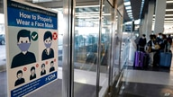 This July 2, 2021 photo shows a sign stating face coverings are required is displayed at O'Hare airport in Chicago.  The nation…