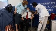 Yehuda Widawsky, a 102-year-old Holocaust survivor, receives a third Pfizer-BioNTech COVID-19 vaccine at a hospital in Tel Aviv, Israel, Aug. 1, 2021.