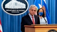 Attorney General Merrick Garland announces in Washington, Aug. 5, 2021, that the Department of Justice is opening an investigation into the city of Phoenix and the Phoenix Police Department.