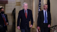 Senate Minority Leader Mitch McConnell, R-Ky., joined by Robert Duncan, R, the secretary for the minority, walks to the chamber as the Senate works to advance the $1 trillion bipartisan infrastructure bill, at the Capitol in Washington, Aug. 2, 2021