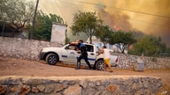 People run away from an advancing fire in Cokertme village, in Bodrum, Mugla, Turkey, Aug. 2, 2021.
