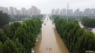 An aerial view shows a flooded road following heavy rainfall in Zhengzhou, Henan province, China, July 23, 2021.