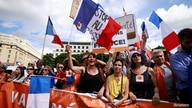 """Protesters attend a demonstration called by the French nationalist party """"Les Patriotes"""" against restrictions, including a compulsory health pass, to fight COVID-19 outside the Ministry of Health in Paris, France, July 31, 2021."""