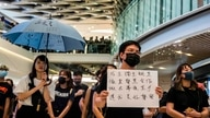Pro-democracy protesters demonstrate in a shopping mall in the district of Yuen Long to mark the two-month anniversary of the triad attack that took place in the Yuen Long train station, in Hong Kong on September 21, 2019. Riot police and protesters…