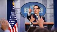 US Secretary of the Treasury Steven Mnuchin speaks in the briefing room of the White House in Washington, DC, on Octopber 11,…