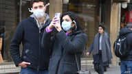 Tourists with protective mask visit Florence on February 25, 2020 as Tuscany reported its first two cases of COVID-19. - Italy…