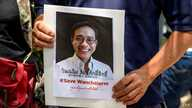A protester holds a portrait of allegedly kidnaped Thai activist Wanchalearm Satsaksit outside the Embassy of Cambodia in…