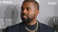 (FILES) In this file photo taken on November 6, 2019, US rapper Kanye West attends the WSJ Magazine 2019 Innovator Awards at…