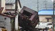 A building structure washed away by flooding due to torrential rain is seen on a street in Hitoyoshi, Kumamoto prefecture on…