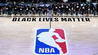 (FILES) In this file photo taken on July 30, 2020, members of the New Orleans Pelicans and Utah Jazz kneel before a Black Lives…