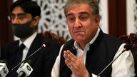 Pakistan's Foreign Minister Shah Mahmood Qureshi (R) speaks during a press conference at the Foreign Ministry in Islamabad on…