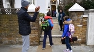 Children are dropped off by their parents at Southbank International School in London on March 8, 2021 as schools reopen…