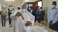 Djibouti's incumbent president Ismail Omar Guelleh (C) casts his ballot at the Ras-Dika district polling station in the capital…