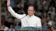 (FILES) This file photo taken on June 30, 2010 shows Philippine President Benigno Aquino waving to the crowd after delivering…