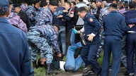 Kazakh police detain a demonstrator during an anti-government protest during the presidential elections in Nur-Sultan, the capital city of Kazakhstan, June 9, 2019.