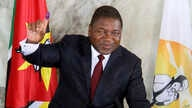 FILE - In this file Tuesday, Oct. 15, 2019 file photo, Mozambican President Felipe Nyusi poses at a polling station where he…