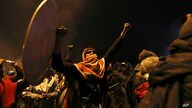 Indigenous and protesters celebrate the announcement that the government cancelled an austerity package that triggered violent…