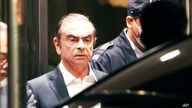 FILE - In this April 25, 2019, former Nissan Chairman Carlos Ghosn leaves the Tokyo Detention Center in Tokyo. A Japanese court…