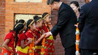 Chinese President Xi Jinping is greeted by Nepalese children upon arrival in Kathmandu, Nepal, Saturday, Oct 12, 2019. Xi on…