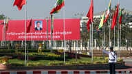 A traffic police stands on a road as he clears a road near a welcoming billboard to Chinese President Xi Jinping Friday, Jan…