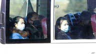 People wear masks as they ride on a public bus in Pyongyang, North Korea Wednesday, Feb. 26, 2020. Uncertainly remained over…