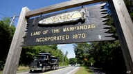 In this Monday, June 25, 2018 photo a wooden sign advises motorists of the location of Mashpee Wampanoag Tribal lands in…