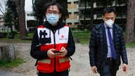 Sun Shuopeng, left, Vice President of China's Red Cross leaves after a press conference with Italian Foreign minister Luigi Di…