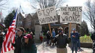 Protesters gather outside Minnesota Gov. Tim Walz' official residence Friday, April 17, 2020, in St. Paul, Minn.,to call on him…
