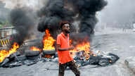 A Somali man protests against the killing Friday night of at least one civilian during the overnight curfew, which is intended…