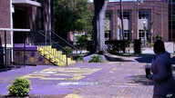 A courtyard typically teaming with Benedict College students is empty, except for one school employee, on Friday, April 3, 2020…