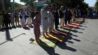 Men attend the Eid al-Fitr prayers outside a mosque in Kabul, Afghanistan, Sunday, May 24, 2020. The Taliban and Afghanistan's…