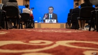 Chinese Premier Li Keqiang speaks on screen during a press conference by video conferencing at the end of the National People's…