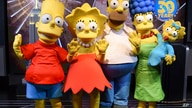 """Costumed characters Lisa Simpson, left, Homer Simpson, Marge Simpson, Maggie Simpson and Bart Simpson participate in Fox's """"The…"""