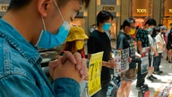 Protesters gather at a shopping mall in Central during a pro-democracy protest against Beijing's national security law in Hong…