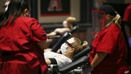 People donate blood during a Red Cross and Arizona Diamondbacks baseball team blood drive at Chase Field Tuesday, April 28,…