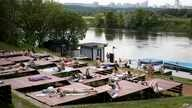 People rest at a one of parks by the Moscow River during a hot day in Moscow, Russia, Tuesday, June 9, 2020. The Russian…