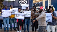 People protest against Coronavirus vaccine trials in Africa, outside the University of the Witwatersrand in Johannesburg, South…