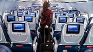 A passenger wears personal protective equipment on a Delta Airlines flight after landing at Minneapolis−Saint Paul…