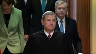Chief Justice John Roberts, followed by Sen. Dianne Feinstein, D-Calif., left, and Senate Judiciary Committee Chairman Lindsey…