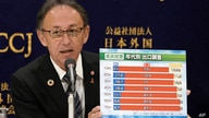 Okinawa Governor Denny Tamaki shows a chart showing a result of a local referendum on U.S. base relocation during a press…