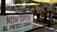 People eat outdoors at San Pedro Square on Monday, July 6, 2020, in San Jose, Calif. The Independence Day weekend saw one of…