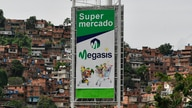 A sign for the first Iranian supermarket that is set to open its doors in Latin America stands near a poor neighborhood in…