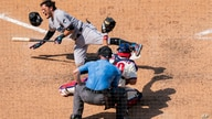 Miami Marlins' Miguel Rojas, left, reacts to getting hit by a pitch during the seventh inning of a baseball game, Sunday, July…