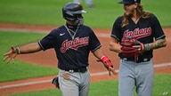 Cleveland Indians' Francisco Lindor, left, talks with starting pitcher Mike Clevinger during a simulated baseball game at…